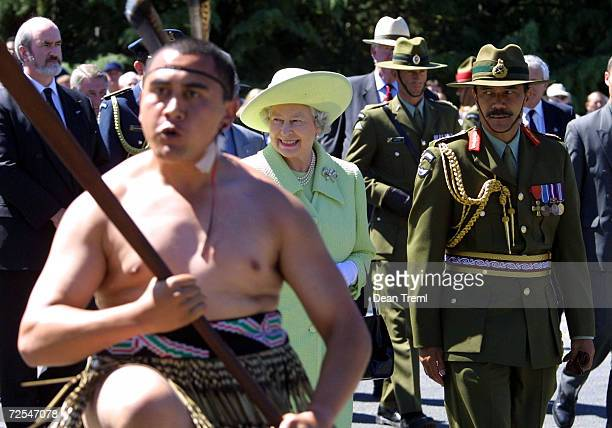 Britains Queen Elizabeth is escorted by Colonel Martin Dransfield ONZM Commander 3rd Land Force Group as a Maori warrior leads the way onto Burnham...