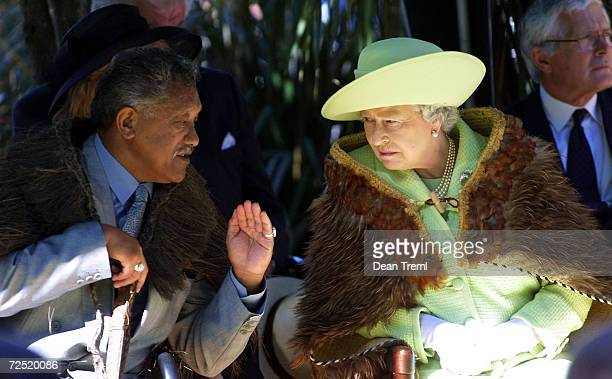 Britains Queen Elizabeth speaks with John Tahuparae MNZM Kaumatua Head Elder of Parliament during a visit to the Rehua Marae a Maori meeting place...