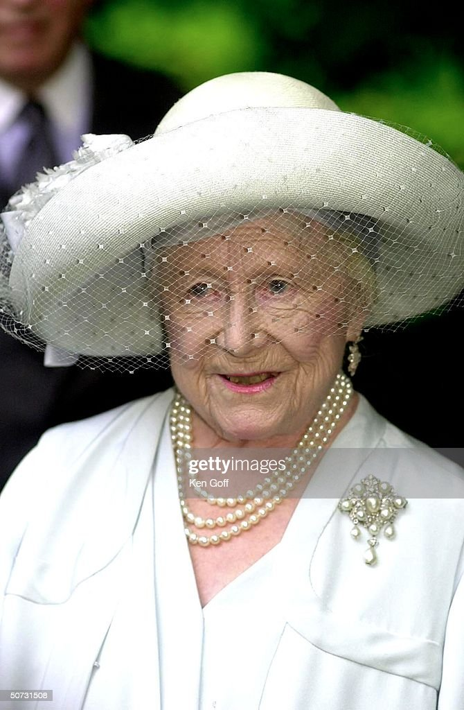 Britain's Queen Mother listening to messages of congratulations on her 100th birthday from both houses of Parliament in the garden at Clarence House.