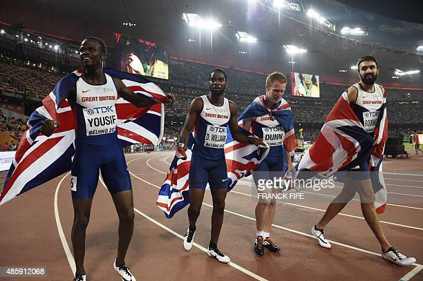 Britain's Rabah Yousif Delanno Williams Jarryd Dunn and Martyn Rooney celebrate winning the bronze medal in the final of the men's 4x400 metres...