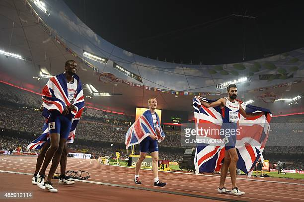 Britain's Rabah Yousif Jarryd Dunn and Martyn Rooney celebrate winning the bronze medal in the final of the men's 4x400 metres athletics event at the...