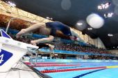 Britain's Rebecca Adlington dives off the starting blocks in the women's 800m freestyle heats swimming event at the London 2012 Olympic Games on...