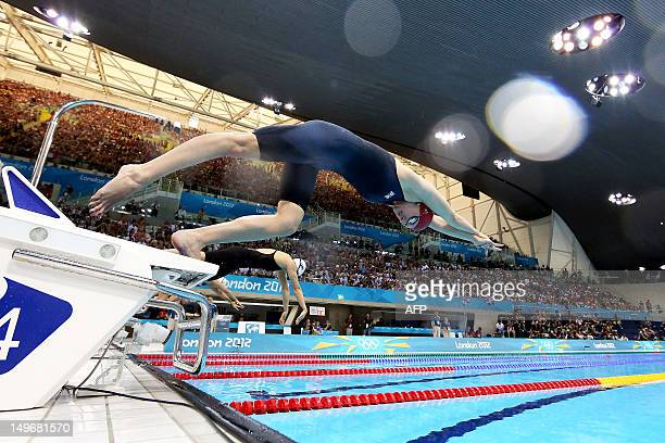 britains rebecca adlington dives off the starting blocks in the womens 800m freestyle heats swimming event