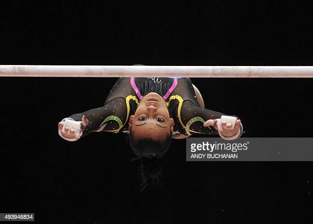 Britain's Rebecca Downie competes on the uneven bars during the first day of qualifications at the 2015 World Gymnastics Championship in Glasgow...