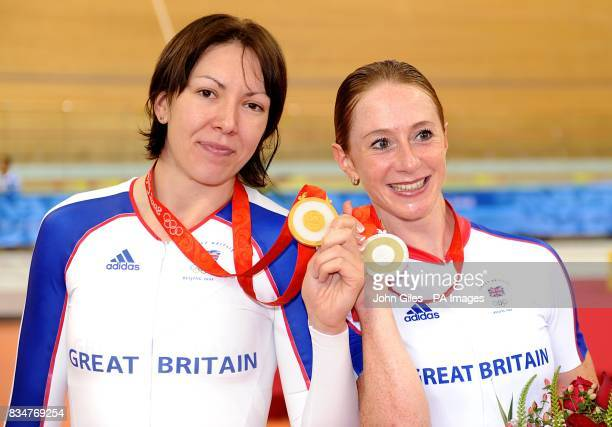Britain's Rebecca Romero and Wendy Houvenaghel pose with their medals after winning the gold and silver medals in the women's individual persuit at...