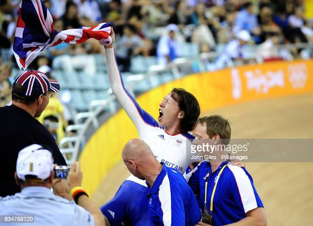 Britain's Rebecca Romero celebrates winning the gold medal in the women's individual persuit with her coach Dan Hunt at the Laoshan Velodrome in...