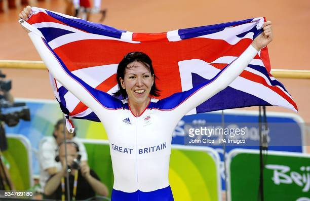 Britain's Rebecca Romero celebrates winning the gold medal in the women's individual persuit at the Laoshan Velodrome in Beijing China during the...
