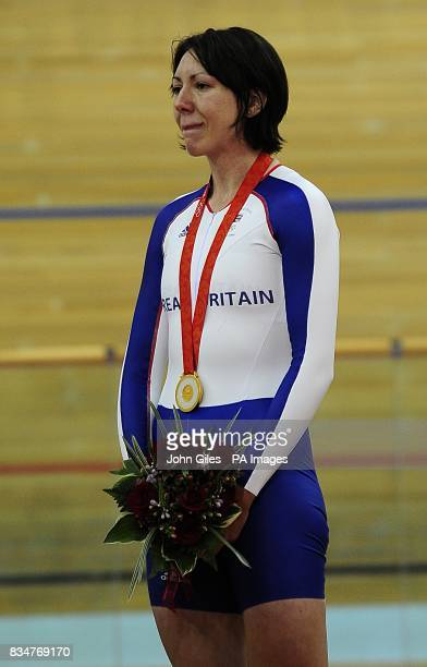 Britain's Rebecca Romero pauses for the National anthem after recieving her gold medal for the women's individual persuit and at the Laoshan...