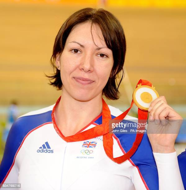Britain's Rebecca Romero poses with her gold medal after winning the women's individual persuit at the Laoshan Velodrome in Beijing China during the...