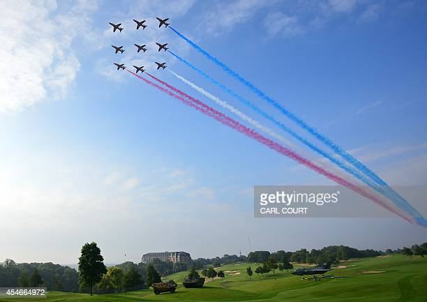 Britain's Red Arrows airplane display team perform a flypast over the NATO 2014 Summit at the Celtic Manor Hotel in Newport South Wales on September...