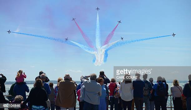 Britain's Red Arrows airplane display team perform during DDay commemorations in Portsmouth in southern England on June 5 2014 Several hundred...