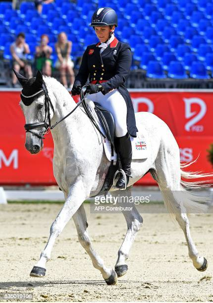 Britain's rider Gemma Tattersall and her horse Quicklook V compete in the dressage competition of the FEI European Eventing Championships in Strzegom...