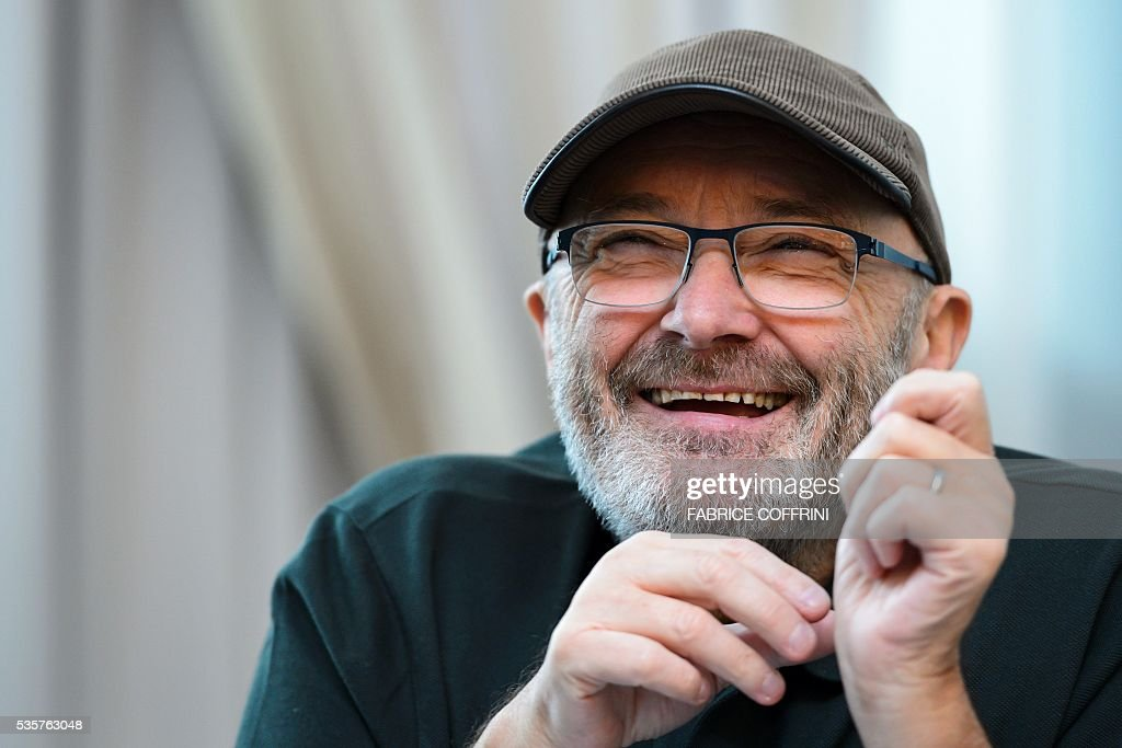Britain's rock star Phil Collins looks on during a press conference for The Little Dreams Foundation gala concert on May 30, 2016 in Lausanne. The Little Dreams Foundation was established by Orianne and Phil Collins in February 2000 to help young talents, regardless of disabilities, to fulfil their dreams in artistic or sportive areas. / AFP / FABRICE