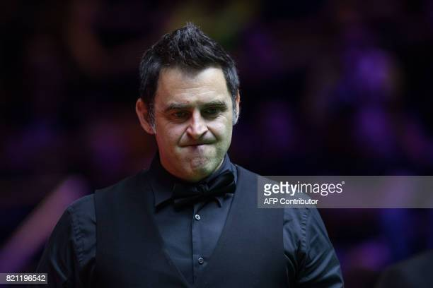 Britain's Ronnie O'Sullivan reacts after a shot against Australia's Neil Robertson during the final of the Hong Kong Masters snooker tournament on...