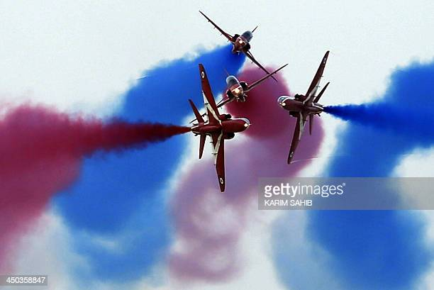 Britain's Royal Air Force Aerobatic Team The Red Arrows performs at the Dubai Airshow on November 18 in the Emirate of Dubai Emirates Airline's...