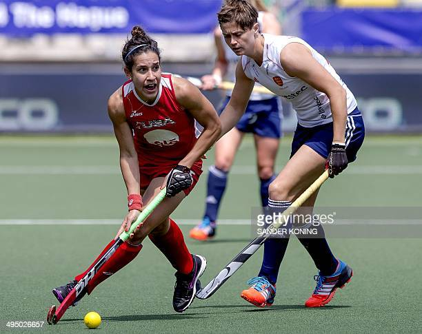 Britain's Sally Walton fights for the ball with Melissa Gonzales of the US during the Field Hockey World Cup 2014 women's tournament group stage...