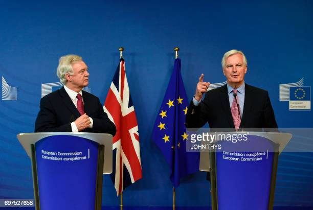 Britain's Secretary of State for Exiting the European Union David Davis and European Union's French chief Brexit negotiator Michel Barnier address a...
