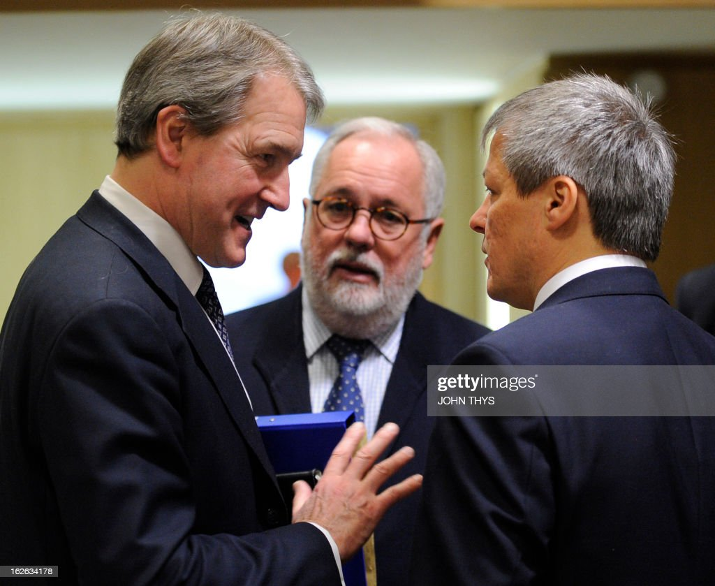 Britain's Secretary of State for the Environment, Food, & Rural Affairs Owen William Paterson talks with Spanish Agriculture and Environment Minister Miguel Arias Canete and EU Agriculture and Rural Development commissioner Dacian Ciolos before an Agriculture Council meeting at the EU Headquarters in Brussels on February 25, 2013. EU agriculture ministers discuss the Europe-wide horsemeat scandal and measures aimed at overhauling the Common Agricultural Policy.