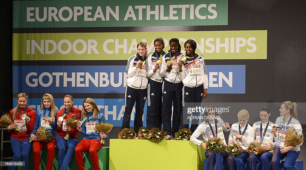 Britain's Shana Cox, Eilidh Child, Christine Ohuruogu and Perri Shakes-Drayton pose on the podium with their gold medal next to second placed Russia's team and third placed Czech team after the 4x400m Woman's Relay Final at the European Indoor Athletics Championships in Gothenburg, Sweden, on March 3, 2013.