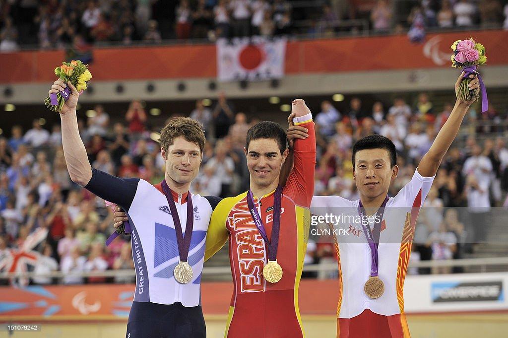 Britain's silver medallist JonAllan Butterworth Spain's gold medallist Alfonso Cabello and China's bronze medallist Liu Xinyang pose on the podium...