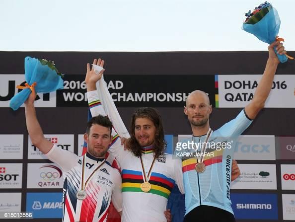 Britain's silver medallist Mark Cavendish Slovakia's gold medallist Peter Sagan and Belgium's bronze medallist Tom Boonen celebrate on the podium at...
