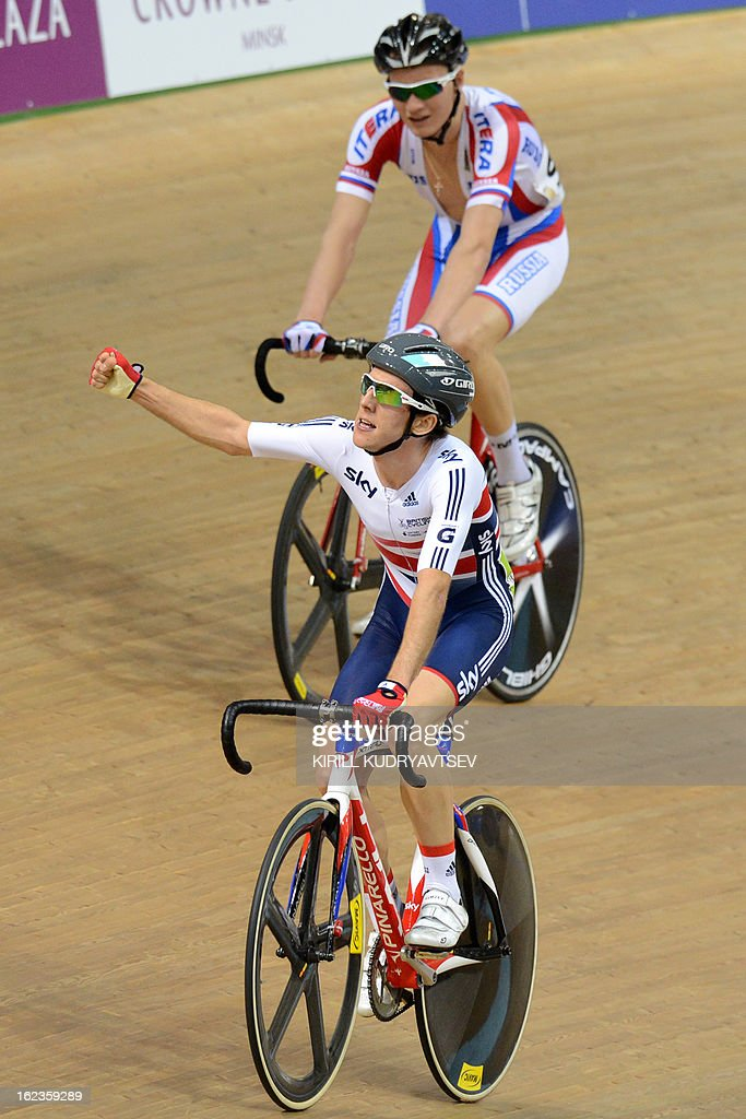 Britain's <a gi-track='captionPersonalityLinkClicked' href=/galleries/search?phrase=Simon+Yates+-+Cyclist&family=editorial&specificpeople=13316516 ng-click='$event.stopPropagation()'>Simon Yates</a> (front, gold medal) and Russia's Kirill Sveshnikov (bronze medal) react after the UCI Track Cycling World Championships Men's 40 km Point Race in Belarus's capital of Minsk on February 22, 2013.