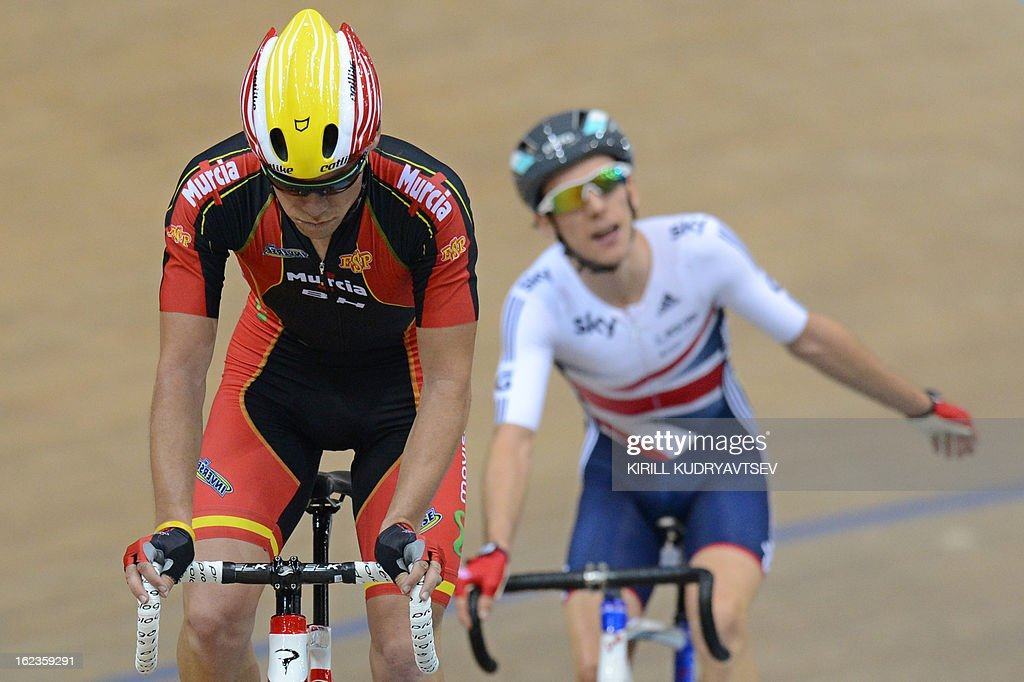 Britain's <a gi-track='captionPersonalityLinkClicked' href=/galleries/search?phrase=Simon+Yates+-+Cyclist&family=editorial&specificpeople=13316516 ng-click='$event.stopPropagation()'>Simon Yates</a> (R, gold medal) and Spain's Eloy Teruel Rovira (L, silver medal) react after the UCI Track Cycling World Championships Men's 40 km Point Race in Belarus's capital of Minsk on February 22, 2013. AFP PHOTO/KIRILL KUDRYAVTSEV