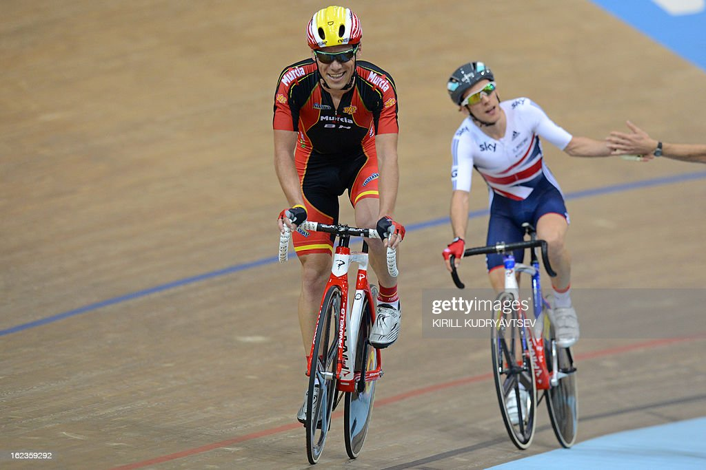Britain's <a gi-track='captionPersonalityLinkClicked' href=/galleries/search?phrase=Simon+Yates+-+Cyclist&family=editorial&specificpeople=13316516 ng-click='$event.stopPropagation()'>Simon Yates</a> (R, gold medal) and Spain's Eloy Teruel Rovira (L, silver medal) react after the UCI Track Cycling World Championships Men's 40 km Point Race in Belarus's capital of Minsk on February 22, 2013.