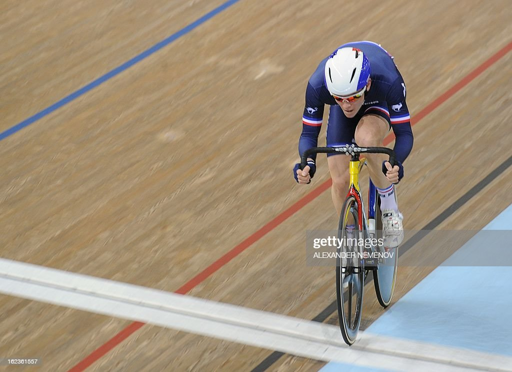 Britain's Simon Yates crosses a finish line of the Men's 40 km Point Race at the UCI Track Cycling World Championships in Minsk on February 22, 2013. AFP PHOTO / ALEXANDER NEMENOV