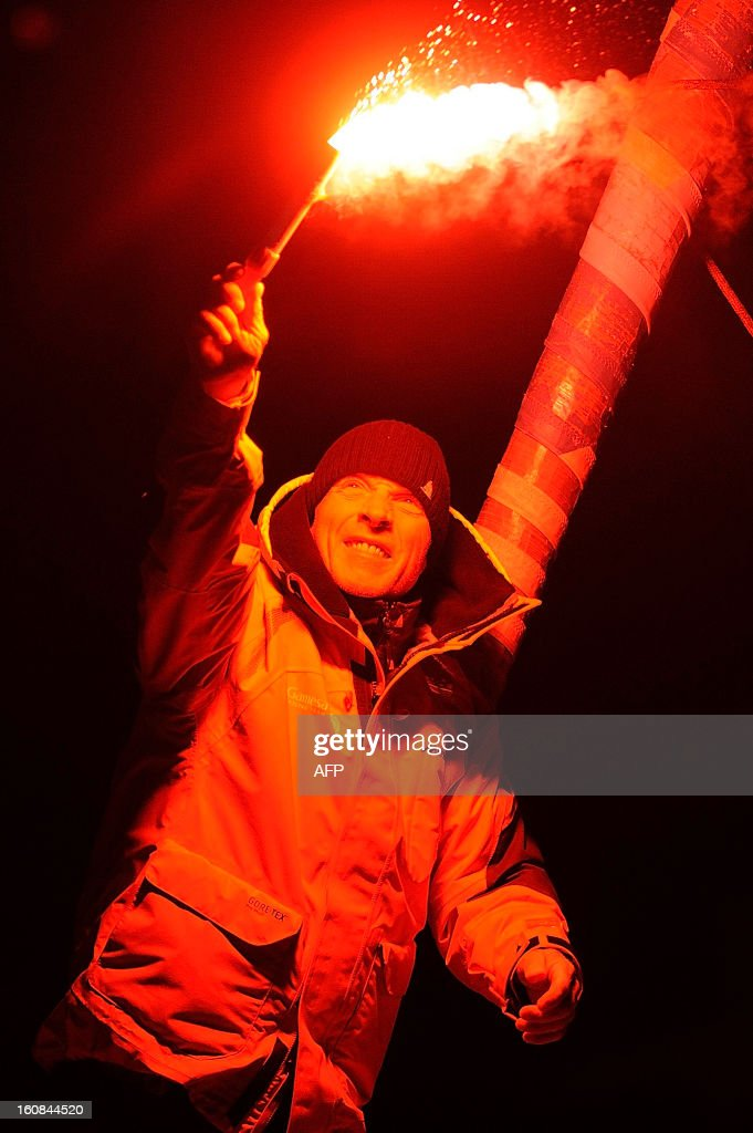 Britain's skipper Mike Golding celebrates on his monohull 'Gamesa' as he finished sixth of the 7th edition of the Vendee Globe solo round-the-world race on February 6, 2013 in Les Sables-d'Olonne, western France. AFP PHOTO JEAN-SEBASTIEN EVRARD