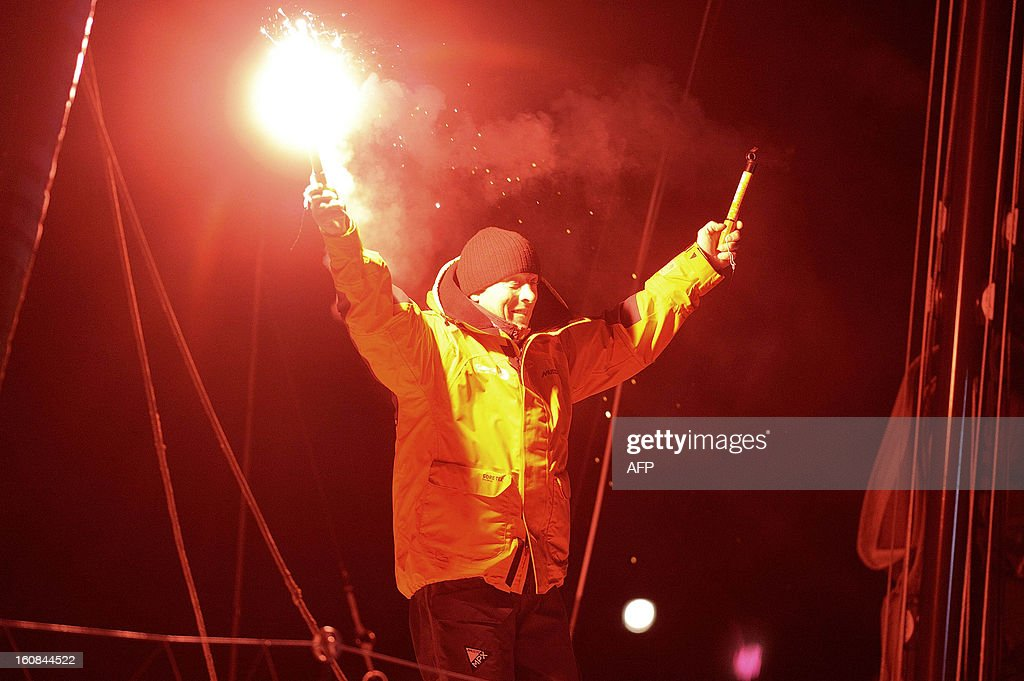 Britain's skipper Mike Golding celebrates on his monohull 'Gamesa' as he finished sixth of the 7th edition of the Vendee Globe solo round-the-world race on February 6, 2013 upon arrival, in Les Sables-d'Olonne, western France.
