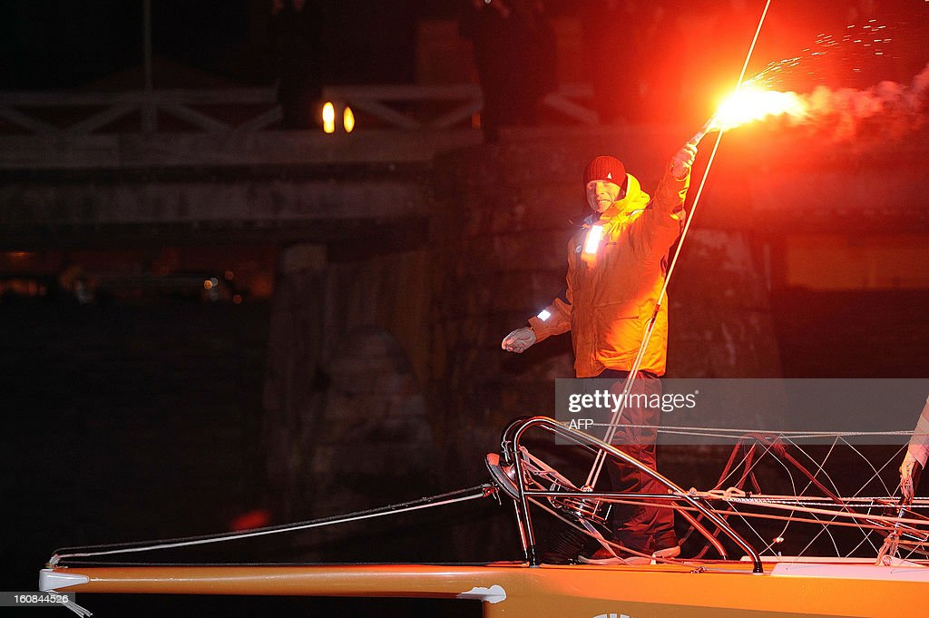 Britain's skipper Mike Golding celebrates on his monohull 'Gamesa' as he finished sixth of the 7th edition of the Vendee Globe solo round-the-world race on February 6, 2013 upon arrival, in Les Sables-d'Olonne, western France. AFP PHOTO JEAN-SEBASTIEN EVRARD