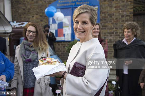 Britain's Sophie Countess of Wessex smiles after being presented with a slice of cake to celebrate her 50th birthday during a visit to Tomorrow's...