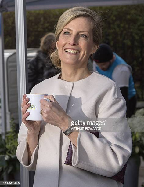 Britain's Sophie Countess of Wessex smiles as she has a warm drink during a visit to Tomorrow's People Social Enterprises St Anselm's Church in...