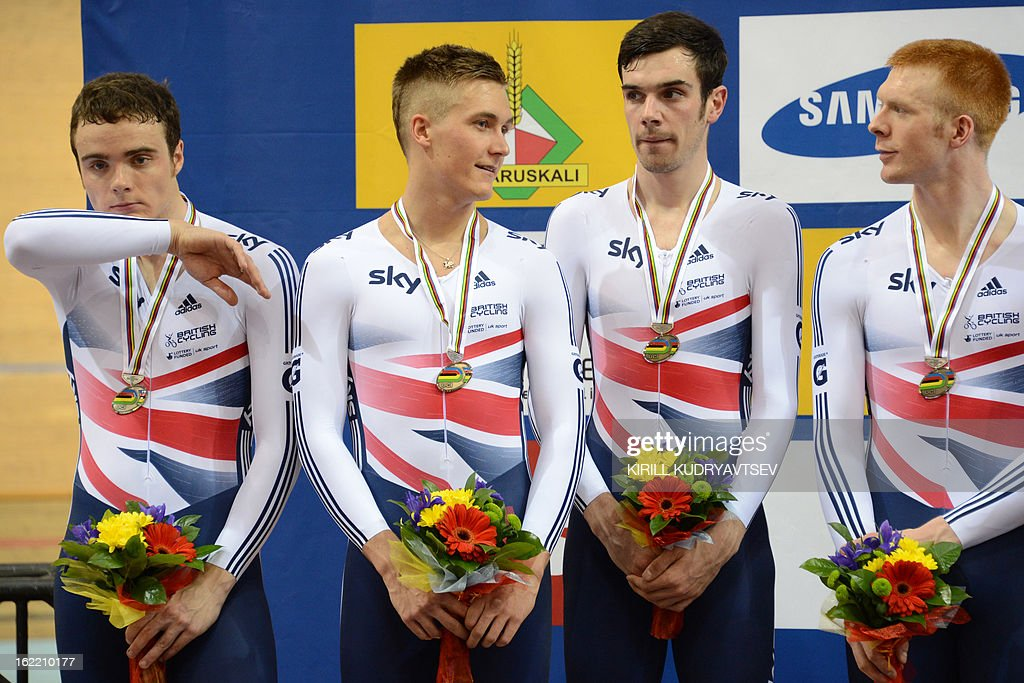 Britain's team react with their silver medals after the UCI Track Cycling World Championships men's team pursuit in Minsk on February 20, 2013. AFP PHOTO/KIRILL KUDRYAVTSEV