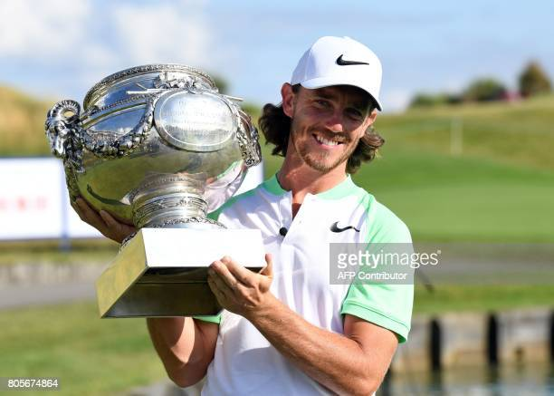 Britain's Tommy Fleetwood poses with the trophy after winning the HNA Open de France golf tournament on July 2 2017 at Le Golf National in Guyancourt...