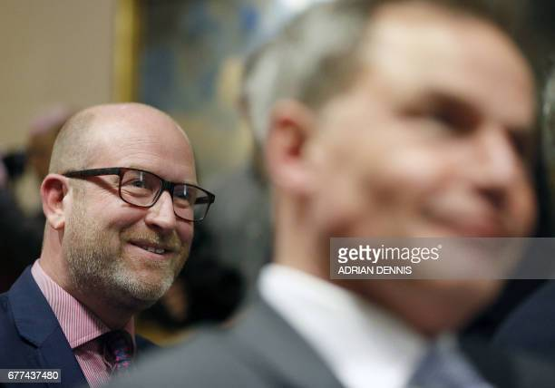 Britain's UKIP leader Paul Nuttall sits amongst journalists as he listens to a policy announcement by UKIP media spokesman and MEP Patrick O'Flynn...