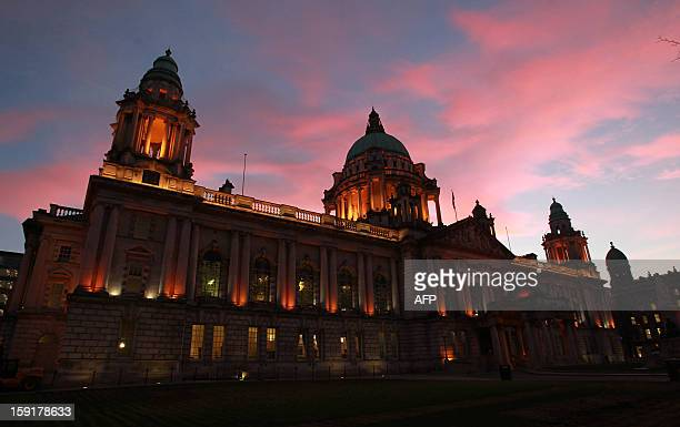 Britain's Union flag flies at dusk at the Belfast City Hall in Belfast Northern Ireland on January 9 2013 after it was hoisted for the day to mark...