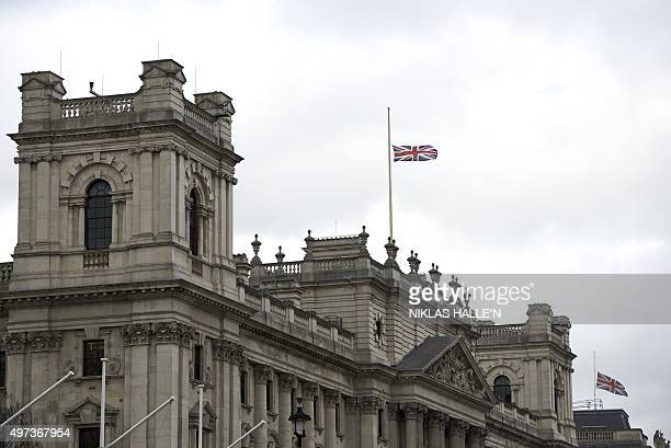 Britain's Union Flag flies at half mast above a government building on Whitehall in central London on November 16 2015 in memory of the victims of...