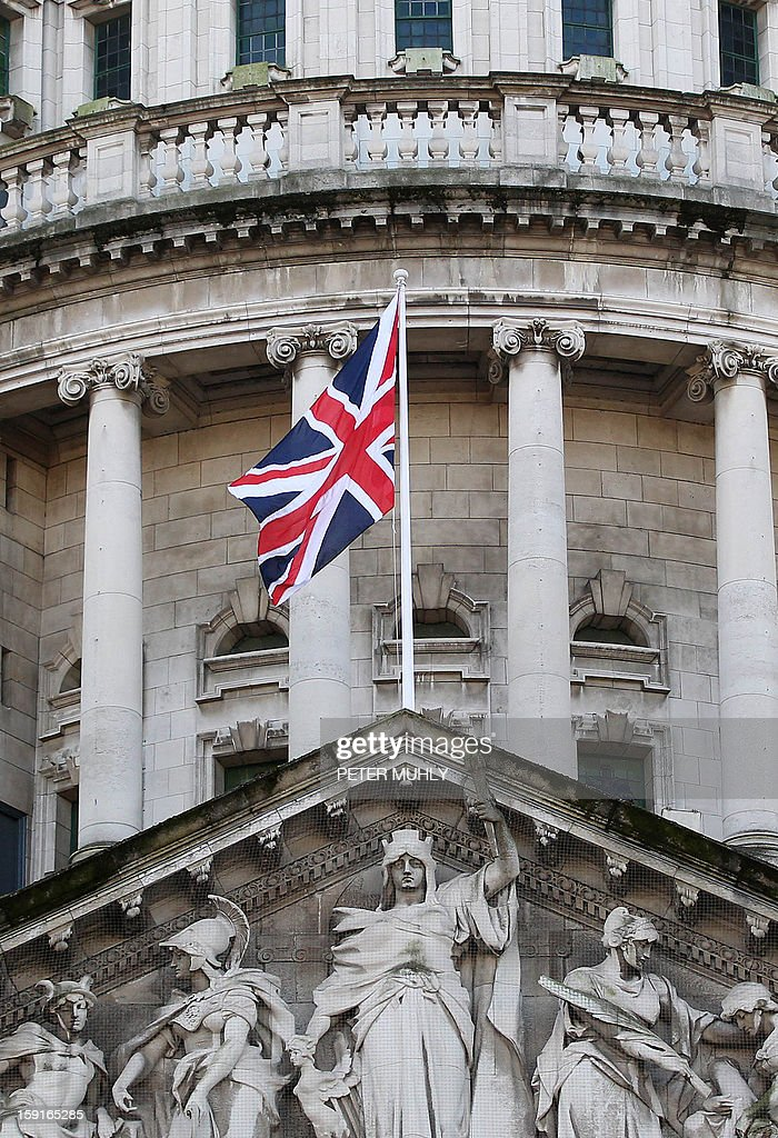 Britain's Union flag flies from the Belfast City Hall in Belfast, Northern Ireland, on January 9, 2013. The British flag was hoisted over Belfast's City Hall on Wednesday for the first time since its removal a month ago sparked riots in Northern Ireland. The emblem will now fly for a maximum of 18 days a year including British royal birthdays -- the first of which fell on Wednesday as Prince William's wife Catherine turned 31. AFP PHOTO / PETER MUHLY