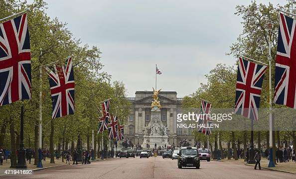 Britain's Union flags line the Mall leading to Buckingham Palace in central London on May 2 2015 Prince William's wife Kate gave birth to a baby girl...