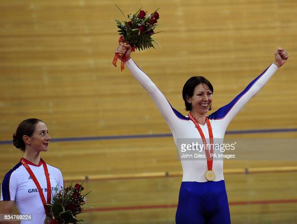 Britain's Wendy Houvenaghel looks on proudly with her silver medal as Britain's Rebecca Romero recieves her gold medal for the women's individal...