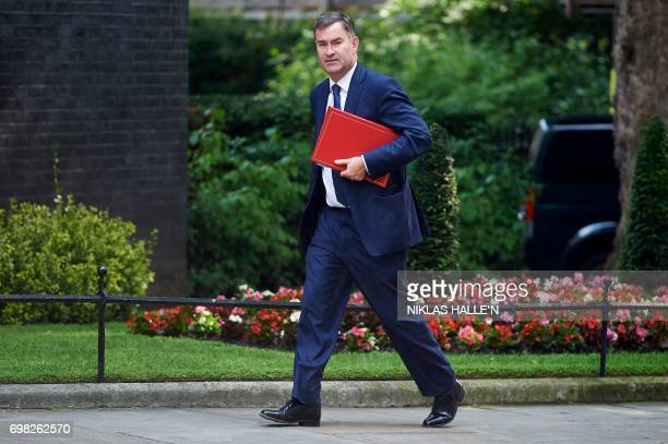 Britain's Work and Pensions Secretary David Gauke arrives to attend a Cabinet meeting at 10 Downing Street in central London on June 20 2017...