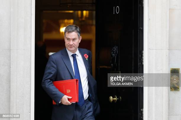 Britain's Work and Pensions Secretary David Gauke leaves 10 Downing Street after the weekly meeting of the cabinet in central London on October 31...
