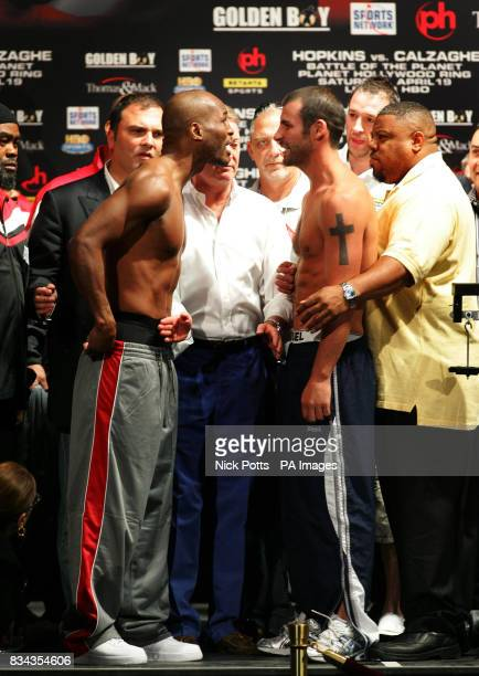 Britain's World Champion boxer Joe Calzaghe stands his ground after he touches heads with American Bernard Hopkins at the weighin at Planet Hollywood...