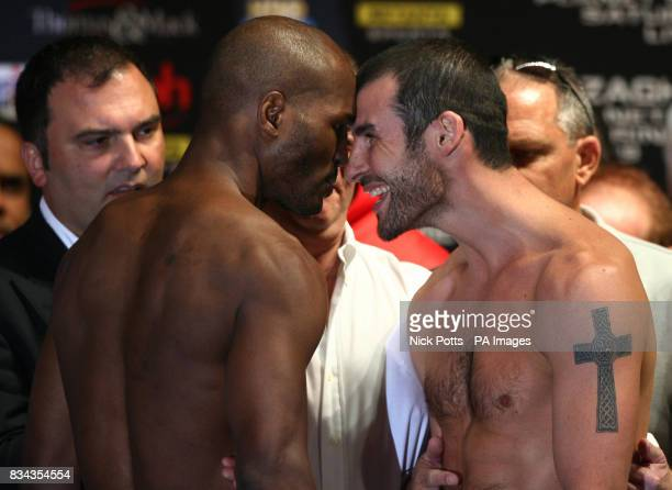 Britain's World Champion boxer Joe Calzaghe touches heads with American Bernard Hopkins at the weightin at Planet Hollywood hotel before Saturday's...