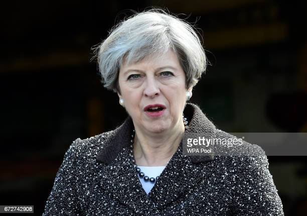 Britain'sPrime Minister Theresa May visits a steel works on April 25 in Newport Wales Theresa May visits Wales on the back of recent poll which...