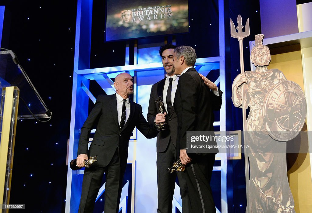 Britannia Award recipients (L-R) actor <a gi-track='captionPersonalityLinkClicked' href=/galleries/search?phrase=Sir+Ben+Kingsley&family=editorial&specificpeople=699878 ng-click='$event.stopPropagation()'>Sir Ben Kingsley</a>, actor <a gi-track='captionPersonalityLinkClicked' href=/galleries/search?phrase=Sacha+Baron+Cohen&family=editorial&specificpeople=216389 ng-click='$event.stopPropagation()'>Sacha Baron Cohen</a>, and actor/filmmaker <a gi-track='captionPersonalityLinkClicked' href=/galleries/search?phrase=George+Clooney&family=editorial&specificpeople=202529 ng-click='$event.stopPropagation()'>George Clooney</a> pose onstage during the 2013 BAFTA LA Jaguar Britannia Awards presented by BBC America at The Beverly Hilton Hotel on November 9, 2013 in Beverly Hills, California.