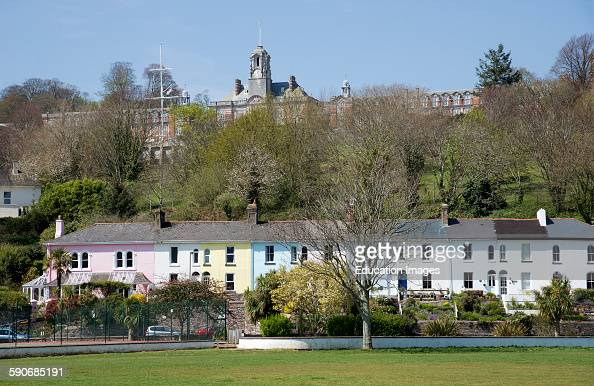 Britannia Royal Naval College and colorful terraced houses in Dartmouth Devon UK