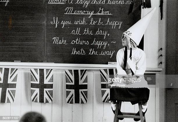 Britannia School House Alison Surtees in dunce cap